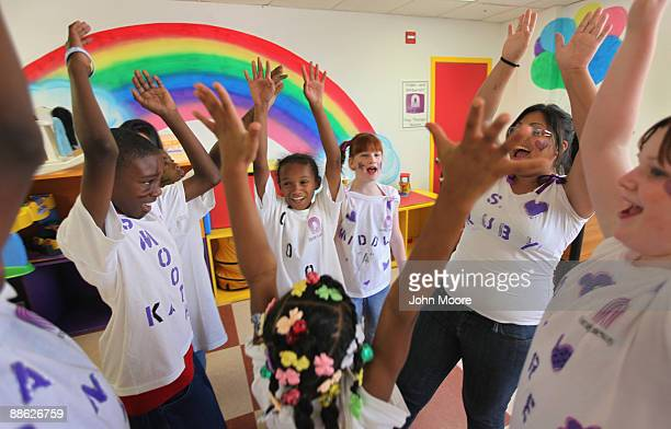 Homeless children practice a dance routine for a talent show at a homeless shelter on June 20, 2009 in Dallas, Texas. She was living with her parents...