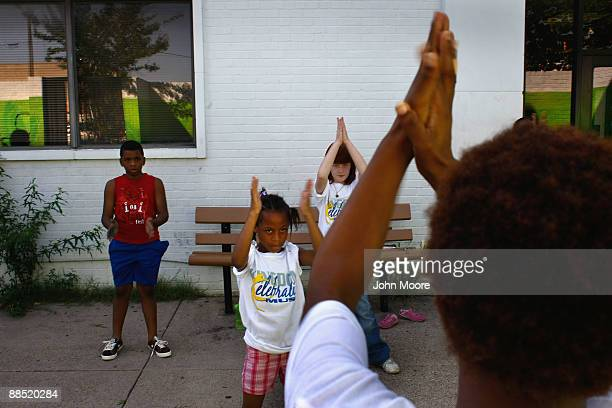 Homeless children practice a dance routine for a talent show at the Family Gateway family homeless shelter on June 15, 2009 in Dallas, Texas. More...
