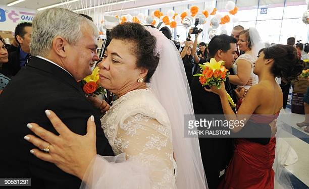 Homeless couple Corey Aldridge and Gwen Whitmore dance after their 99 cent wedding ceremony at the 99 cent store in Los Angeles on September 9 2009...