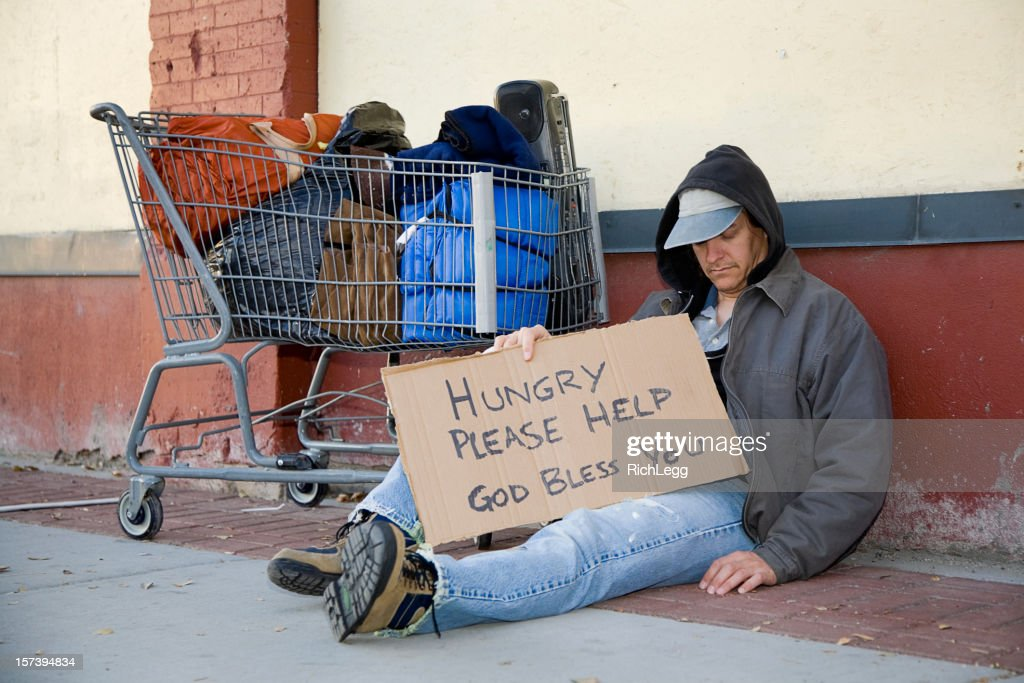 Homeless Couple on a City Street : Stock Photo