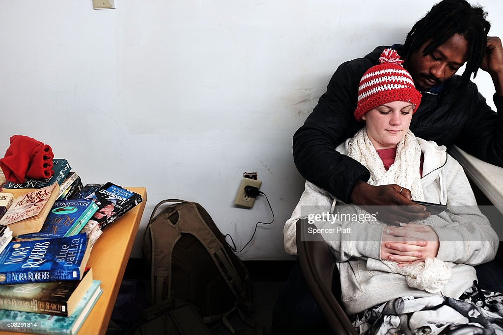 A homeless couple rest at the Seashore Mission which offers services to the homeless and those in need on January 3, 2016 in Biloxi, Mississippi. According to the US Census Bureau, Mississippi is the nation's poorest state with a median income of $39,680. The city of Biloxi has struggled to make progress after the devastating flooding from Hurricane Katrina in 2005.