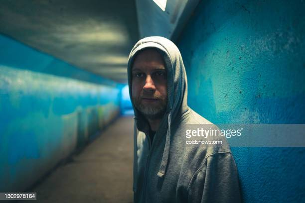 homeless depressed man in underpass - male bum stock pictures, royalty-free photos & images