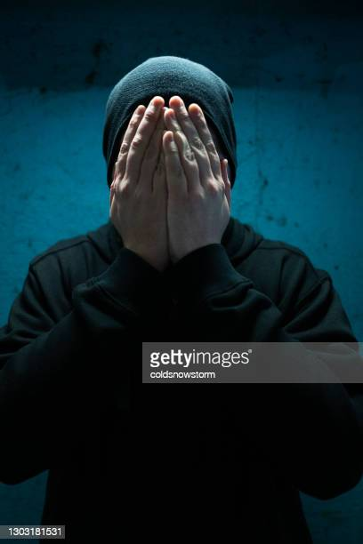 homeless depressed man with hands over face in despair - male bum stock pictures, royalty-free photos & images