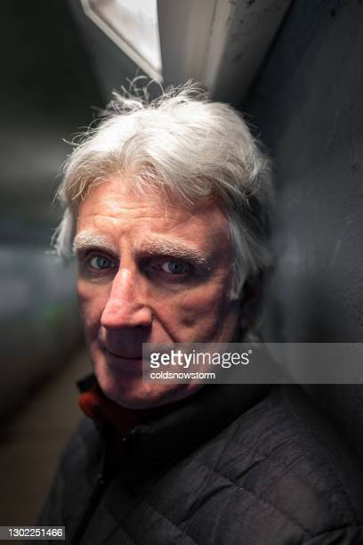 homeless depressed senior man in underpass - male bum stock pictures, royalty-free photos & images