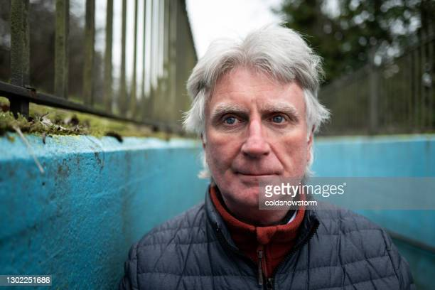 homeless depressed senior man on city street - male bum stock pictures, royalty-free photos & images