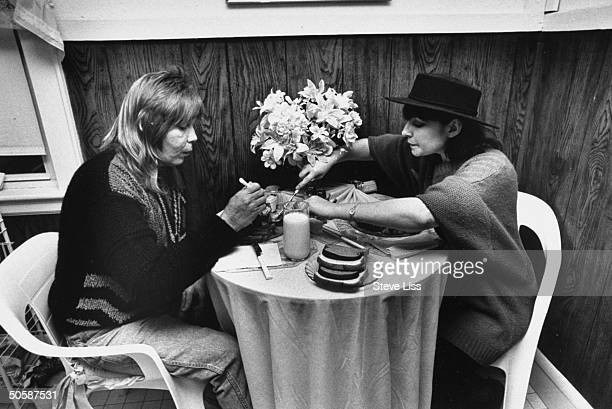 Homeless derelict Christopher Dickinson who impersonated drummer Peter Criss in an attempt to obtain benefactors having lunch w socalled Criss friend...