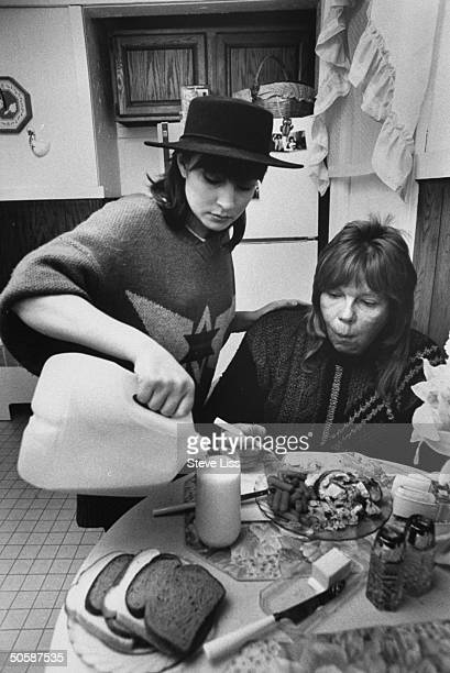 Homeless derelict Christopher Dickinson who impersonated drummer Peter Criss in an attempt to obtain benefactors having lunch as Cheryl Ann Thompson...