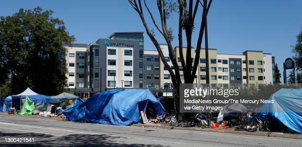 Homeless encampment along Wolfe Road next to Vallco in Cupertino, Calif., on Tuesday, May 26, 2020. In the background is the Hyatt House Hotel.