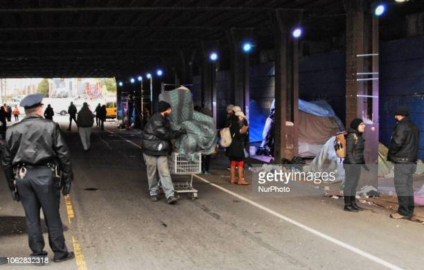 Homeless Encampment Eviction In Philadelphia USA on November 15 2018 A homeless tent community under the railroad trestles are roused early on their...