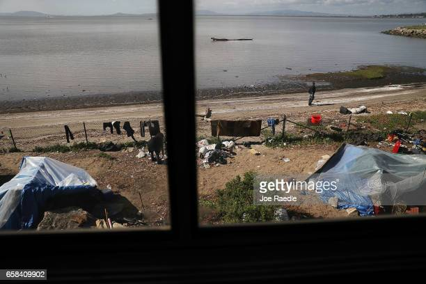 A homeless encampment is seen as Amtrak's California Zephyr passes along San Pablo Bay as it comes close to the end of its daily 2438mile trip to...