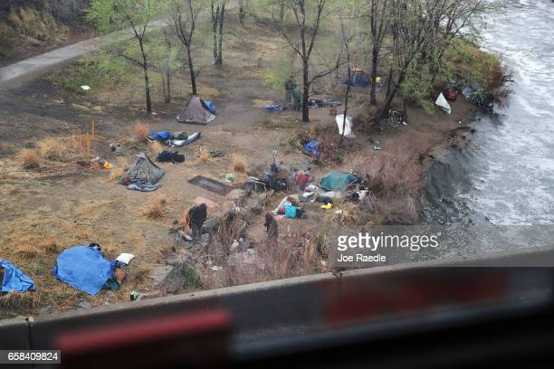 A homeless encampment is seen as Amtrak's California Zephyr pulls out of the Denver Union rail station during its daily 2438mile trip to...