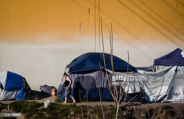 A homeless encampment is seen near a dried up river bed in Stockton California on February 7 2020 The city went bankrupt in 2012 but has been...