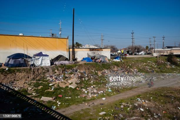 Homeless encampment is seen near a dried up river bed in Stockton, California on February 7, 2020. - The city went bankrupt in 2012 but has been...