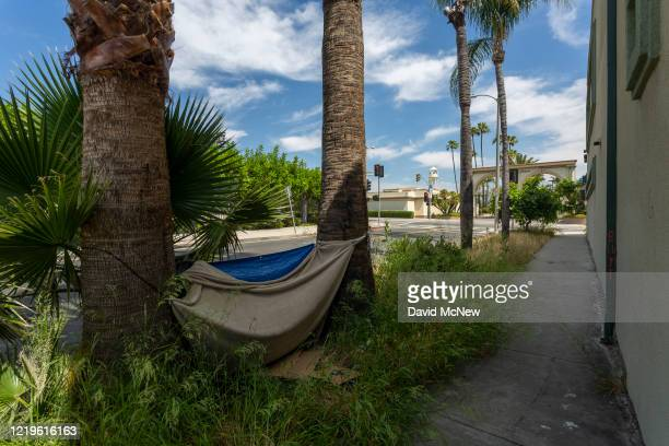 Homeless encampment is seen near the gates of Paramount Pictures Studios as Los Angeles County allows more businesses and facilities to reopen today,...