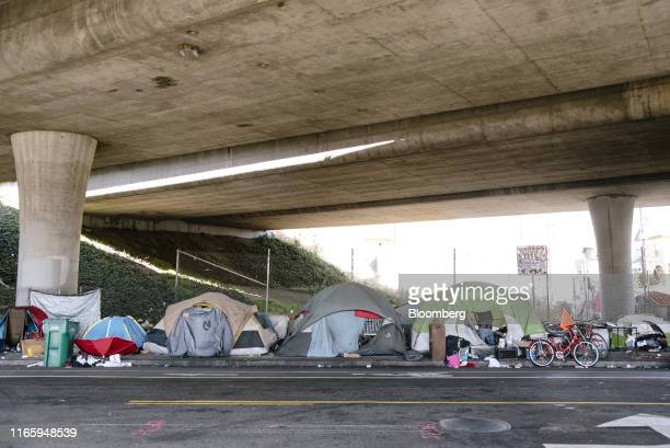 Homeless encampment is seen on Martin Luther King Jr. Way in Oakland, California, U.S., on Friday, Aug. 30, 2019. Builders in Oakland are on course...