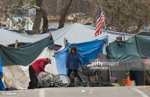 A homeless encampment made of tents and tarps lines the Santa Ana riverbed near Angel Stadium in Anaheim California January 25 2018 People living...