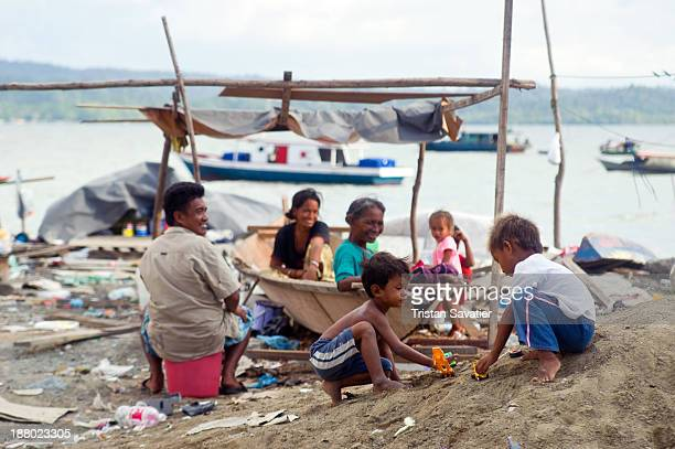 CONTENT] Homeless families living on small boats on a seashore wasteland covered with trash in the town of Lahad Datu This family is living in a...