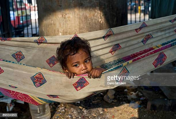 A homeless family from Tamil Nadu sleeping under a bridge of a newly built highway in Mumbai Despite having more millionaires than any other city in...