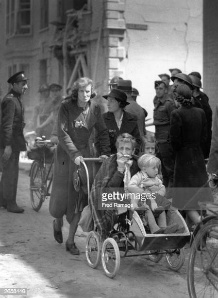 A homeless family in the bombed streets of Canterbury during World War II