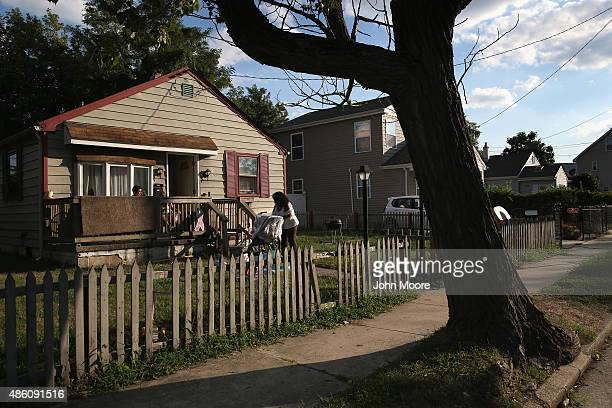 Homeless grandmother Valencia Terrell tends to her grandchild while staying temporarily at a friend's home on August 26 2015 in Atlantic City New...