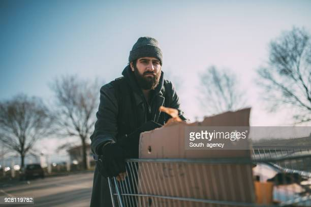 homeless guy pushing shopping cart - homeless person stock pictures, royalty-free photos & images