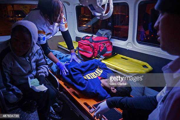 A homeless HIVAIDS patient suffering pneumonia waits to be taken to a hospital January 11 2014 in Guatemala City Guatemala The bomberos voluntarios...