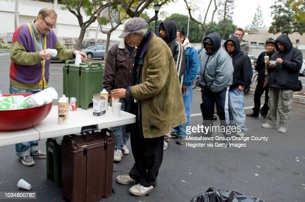 Homeless in downtown Santa Ana line up for hot bowls of chili and coffee from the Orange County Rescue Mission's Chili Van ///ADDITIONAL INFORMATION...