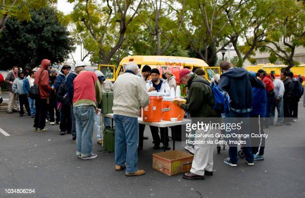 Homeless in downtown Santa Ana line up for hot bowls of chili from the Orange County Rescue Mission's Chili Van ///ADDITIONAL INFORMATION...