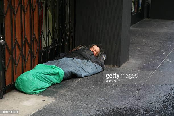 Homeless in sleeping-bag on the street