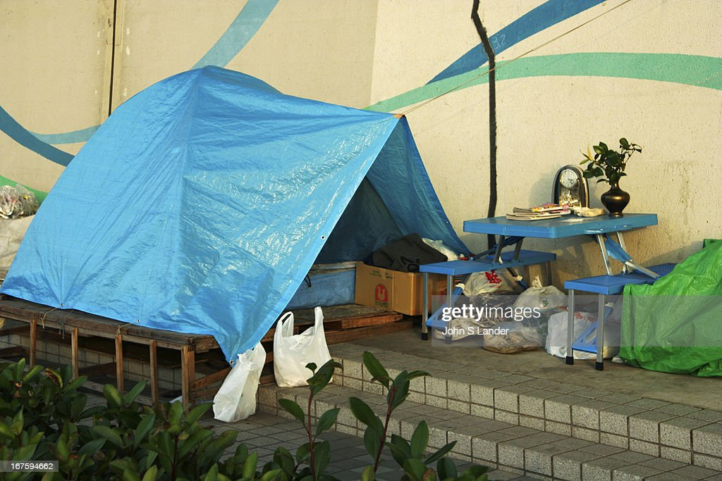Homeless in Tokyo along the bank of the Sumida River, posing... : News Photo