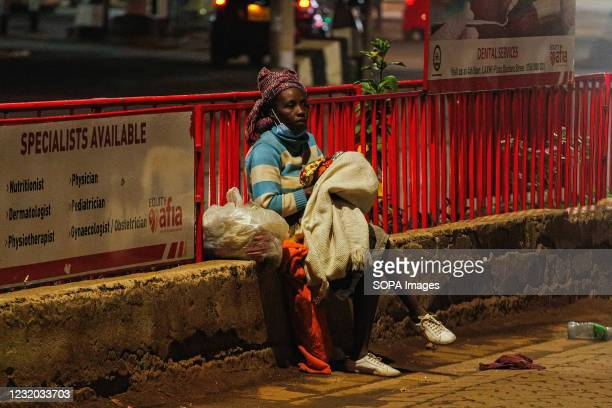 Homeless Kenyan lady holding her baby as she ponders her next move as the new 8pm-4am curfew takes effects. On Friday, March 26th, President Uhuru...