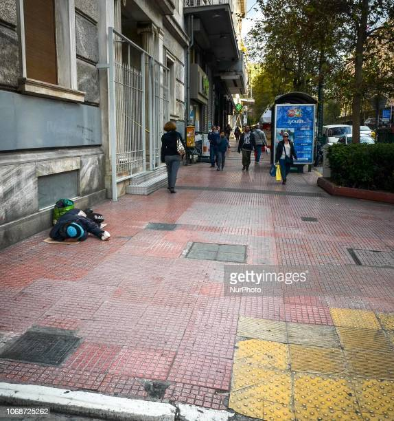 A homeless lays on the pavement as he is begging for some money in Athens Greece 5 December 2018 22% of GDP growth for the third quarter of the year...