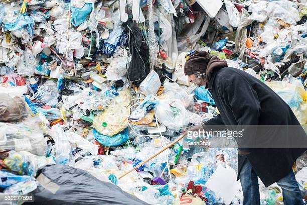 Homeless Looking for in a Garbage Dump