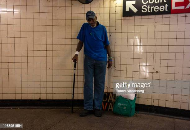 Homeless man asks for a contribution outside the Borough Hall subway station in Brooklyn, New York on August 8, 2019. There are approximately 63,000...