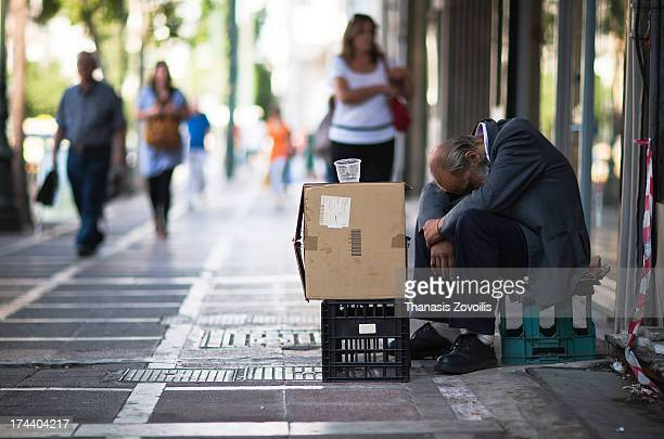 CONTENT] A homeless man beg for money in AthensGreece