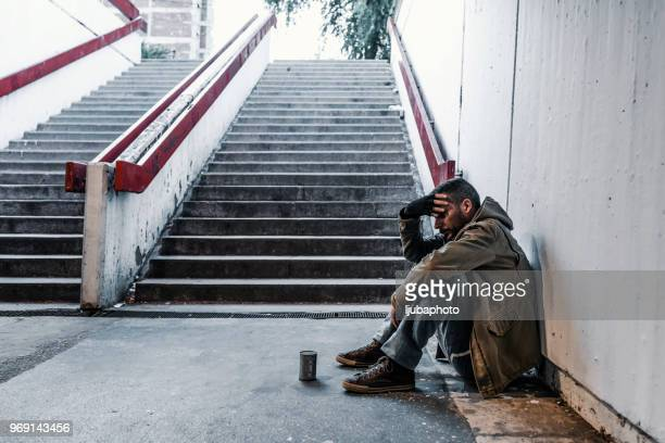 homeless man begging for money - homeless veterans stock photos and pictures