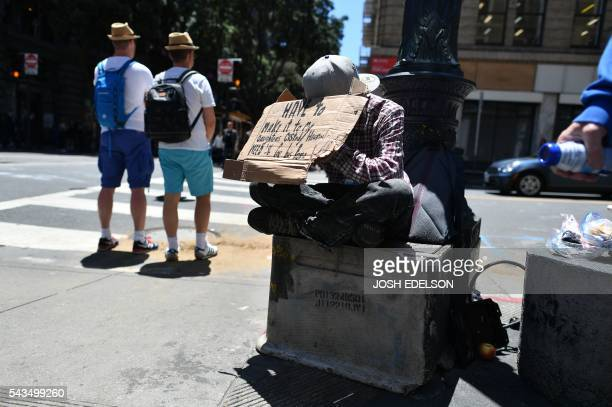 A homeless man begs along a sidewalk in downtown San Francisco California on Tuesday June 2016 Homelessness is on the rise in the city irking...
