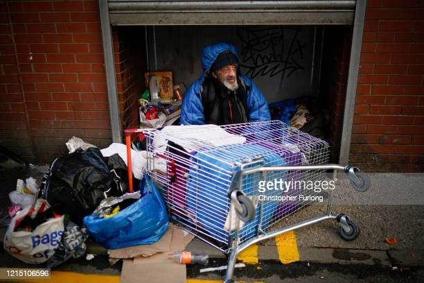 A homeless man begs for small change after sleeping in a doorway as it has been reported that homeless charities are requesting that all homeless...