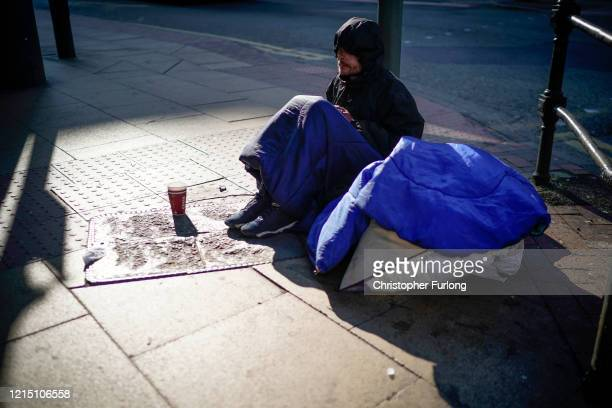Homeless man begs for small change as it has been reported that homeless charities are requesting that all homeless people in England should be in...