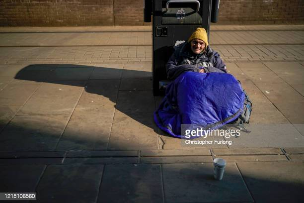 A homeless man begs for small change as it has been reported that homeless charities are requesting that all homeless people in England should be in...