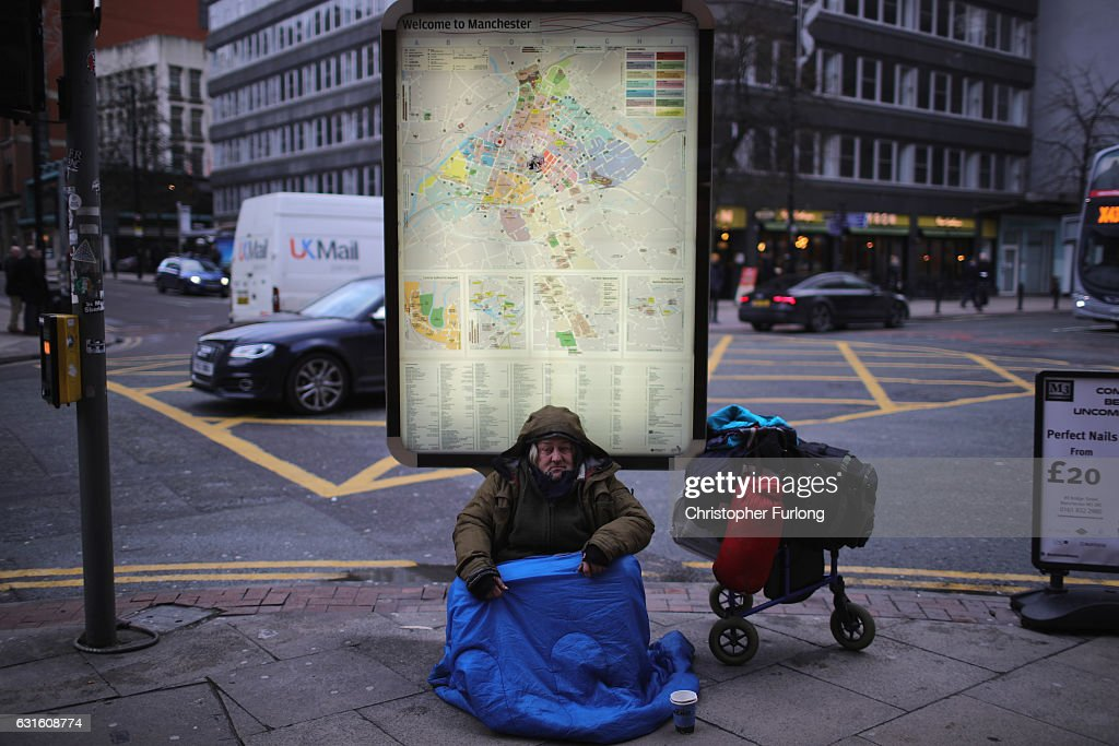 A homeless man begs for small change on the streets of Manchester on January 13, 2017 in Manchester, United Kingdom. Many homeless people are spending the night on the streets in freezing temperatures as the Met Office continues to issue weather warnings across the country. Despite work by charities to help the homeless. Official figures record that there were 1,850 people sleeping rough in the whole of England in 1998, in a 2015 survey the figure has jumped to 8,096 sleeping on the streets in London alone