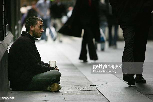 A homeless man begs for small change on the streets on October 5 2005 in Glasgow Scotland UK Homeless charity Shelter figures show that 85286 people...
