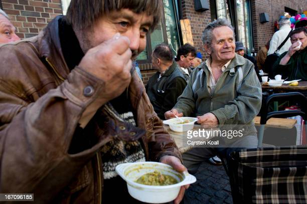 A homeless man eats a soup during a street fest for homeless people held by the Bahnhofsmission homeless kitchen on April 20 2013 in Berlin Germany...