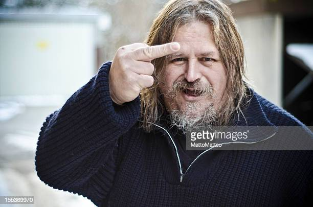 Homeless man flips the bird