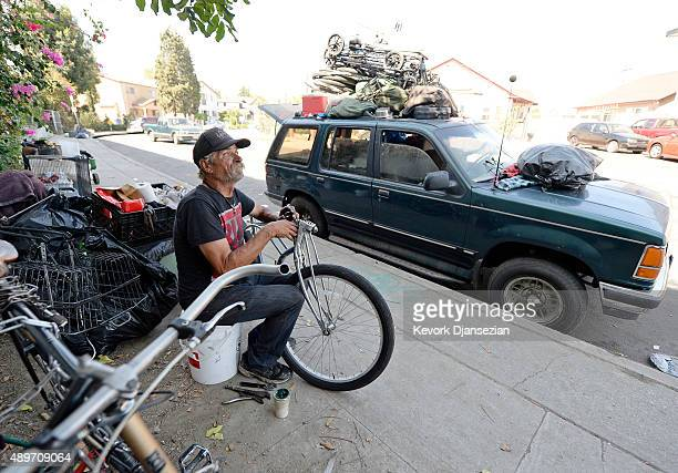 A homeless man for over 30 years leaving inside his car repairs a bicycle September 23 in the Hollywood section of Los Angeles California Mayor Eric...