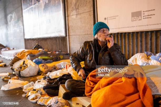 A homeless man from USA smokes a cigarette on January 29 2020 in Berlin Germany Approximately 3700 volunteers will fan out in teams across the city...