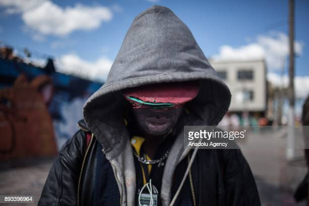 A homeless man getting some food provided by volunteers is seen in Bogota Colombia on December 15 2017 Homeless people who are called 'CHC'...