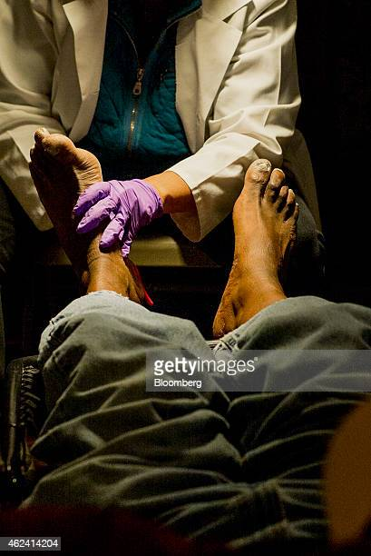 A homeless man has his feet cleaned inside St Boniface Church in the Tenderloin district of San Francisco California US on Monday Jan 19 2015 In a...