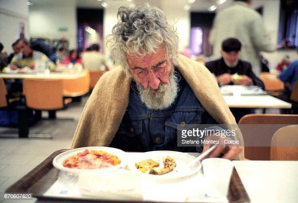A homeless man has lunch in the refectory Caritas Via Marsala in Rome Italy