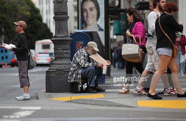 A homeless man holds a sign as he panhandles for spare change on September 16 2010 in San Francisco California The US poverty rate increased to a 143...
